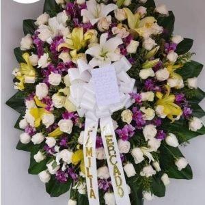 Ramos de Flores Funebres - Se compone Corona fúnebre rosas blancas ,orquídeas hawaianas ,lirios y perlas Para mas información: Celular: (+57) 316 705 28 09
